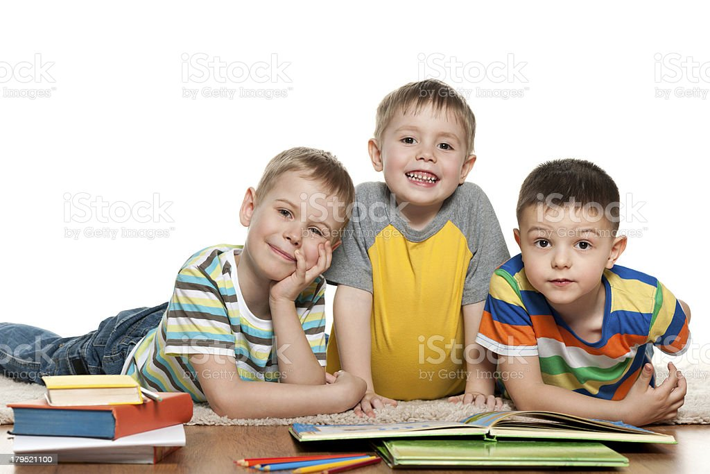 Boys reading on the floor royalty-free stock photo