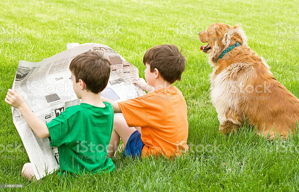 Boys Reading the Newspaper royalty-free stock photo