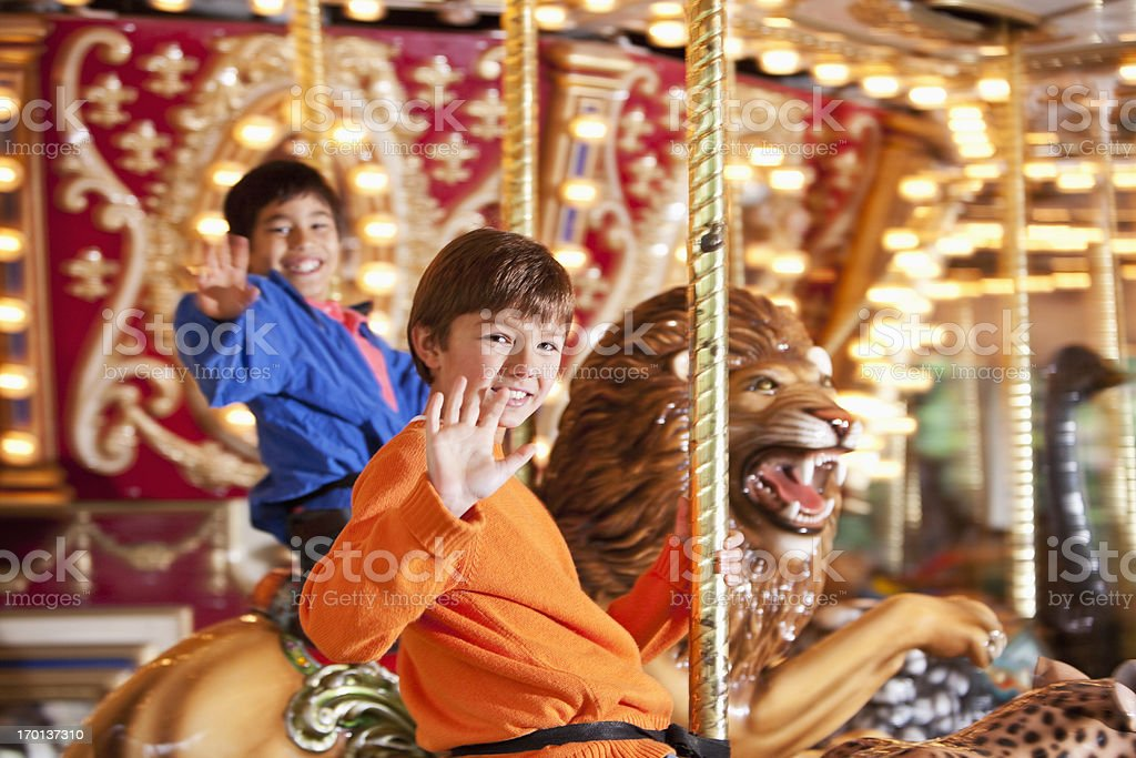 Boys riding carousel royalty-free stock photo