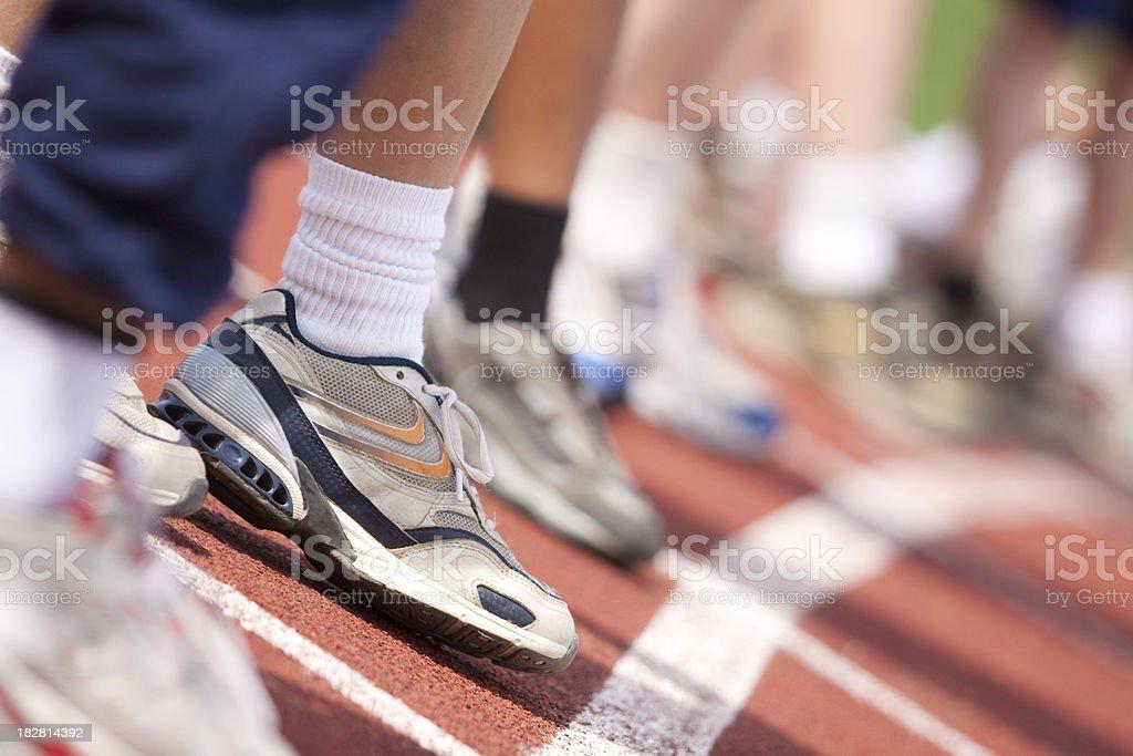 Boys running shoe at starting line stock photo