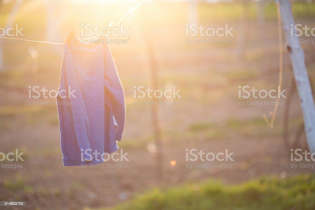 Boys shirt hanged to dry stock photo