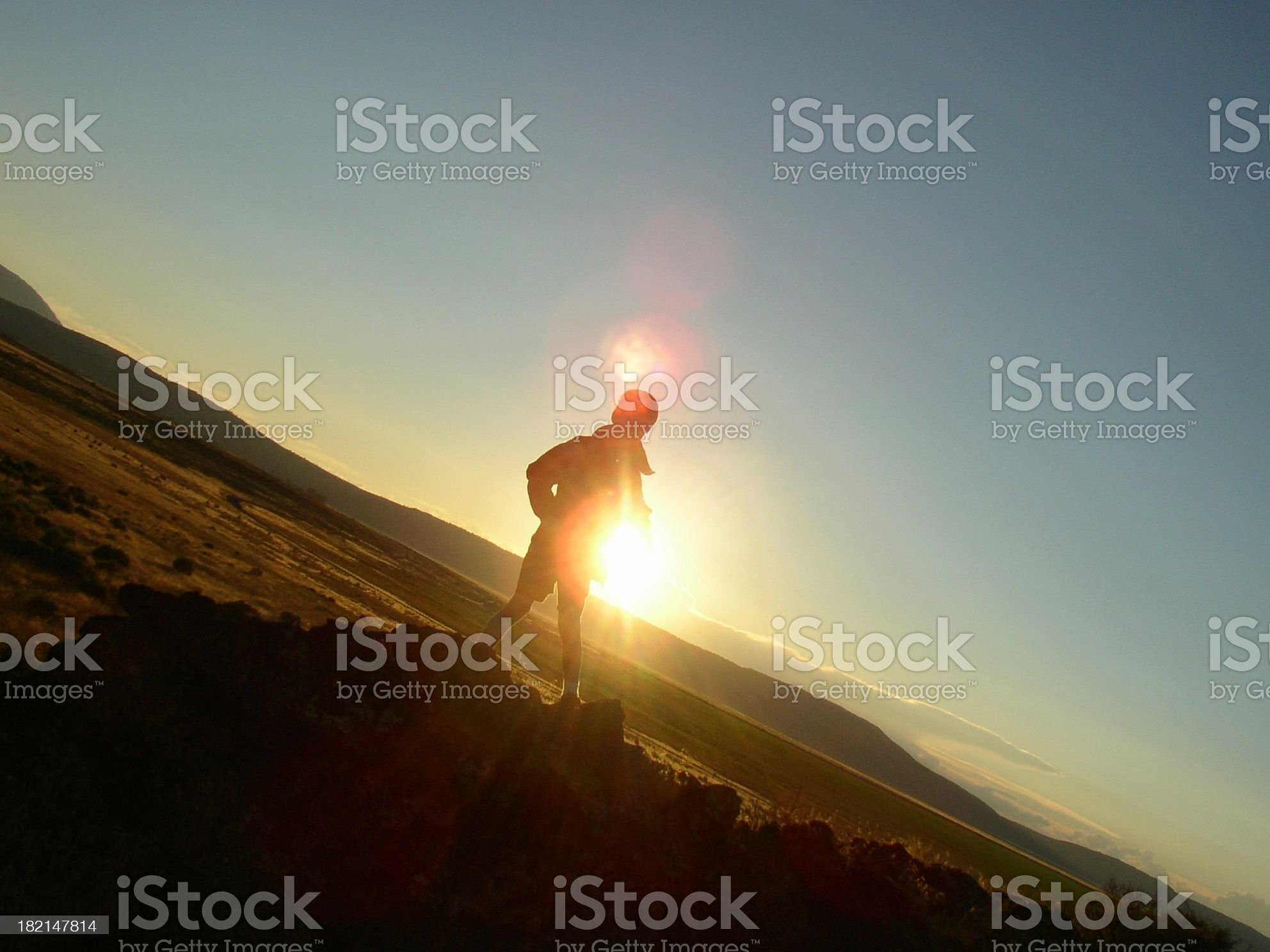 boy's silhouette at sunset royalty-free stock photo