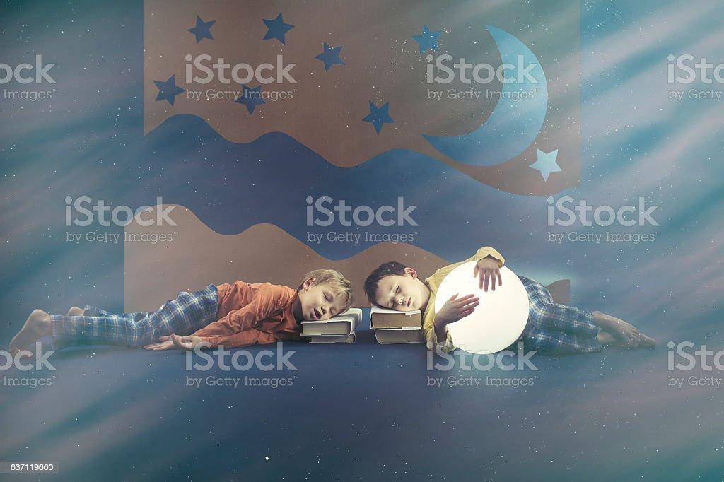 Boys sleeping on books stock photo