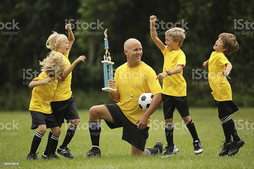 Boys Soccer Team Cheering And Celebrating On Field royalty-free stock photo