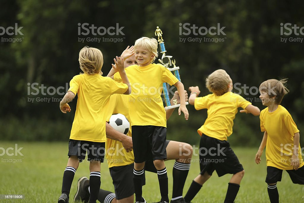 Boys Soccer Team Cheering And Celebrating royalty-free stock photo