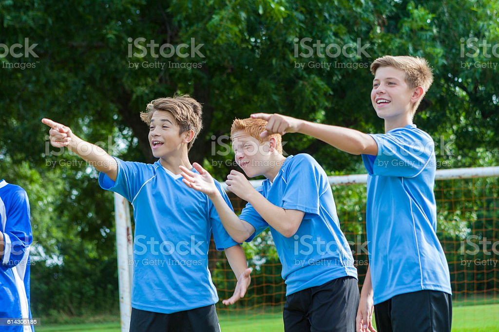 Boys soccer team object to referee's call stock photo