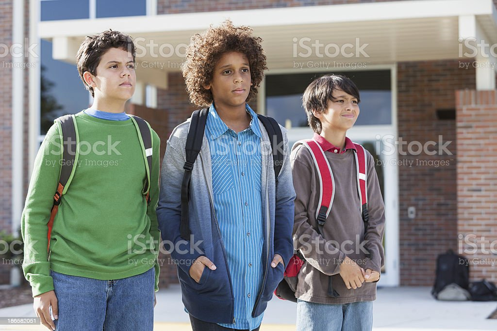 Boys standing outside school stock photo