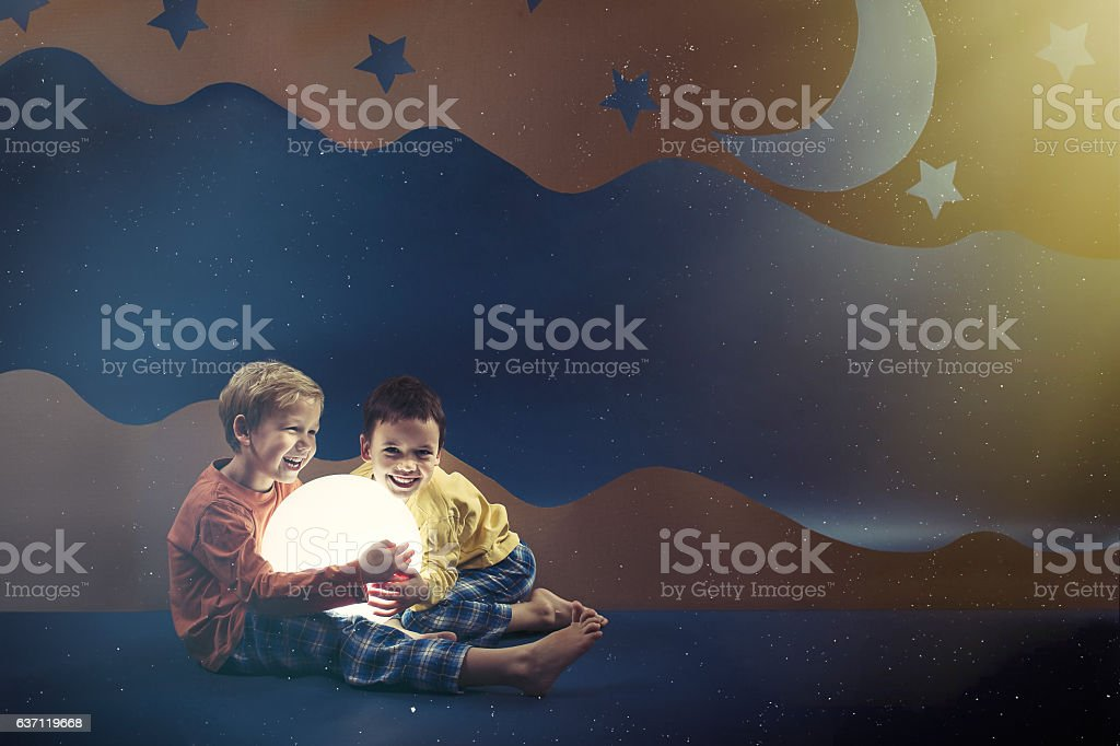 Boys surrounded by night background stock photo