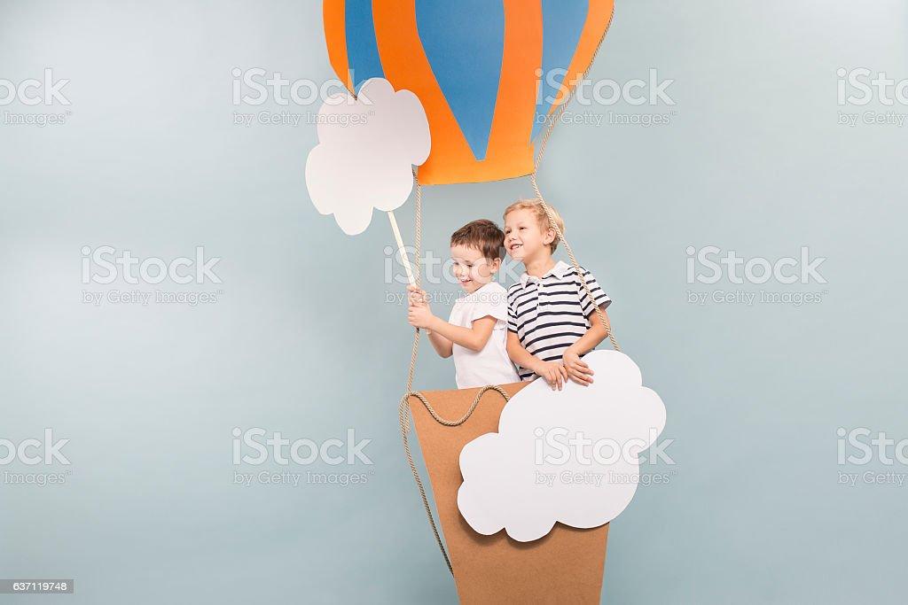 Boys taking a baloon flight stock photo