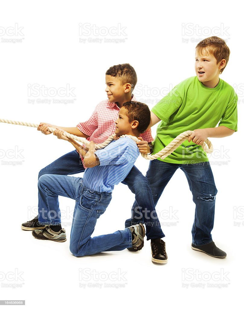 Boys team pulling the rope royalty-free stock photo