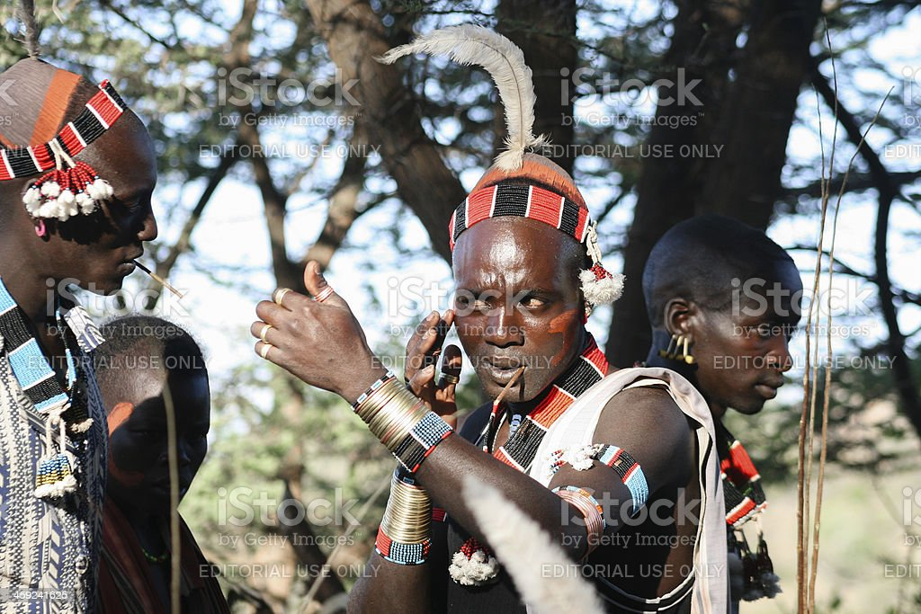 Boys wear makeup for the bull jumping ceremony, Ethiopia royalty-free stock photo