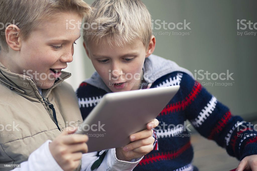 Boys with a tablet computer stock photo