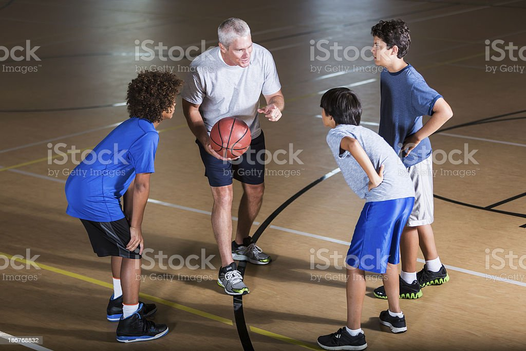 Boys with basketball coach royalty-free stock photo
