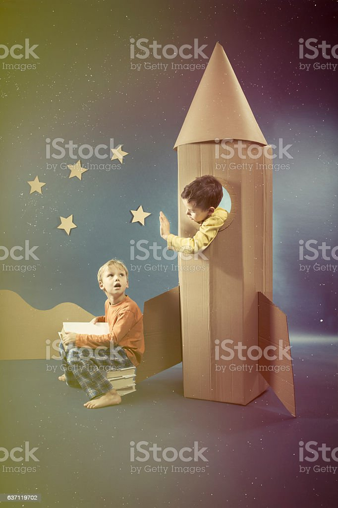 Boys with paper rocket stock photo