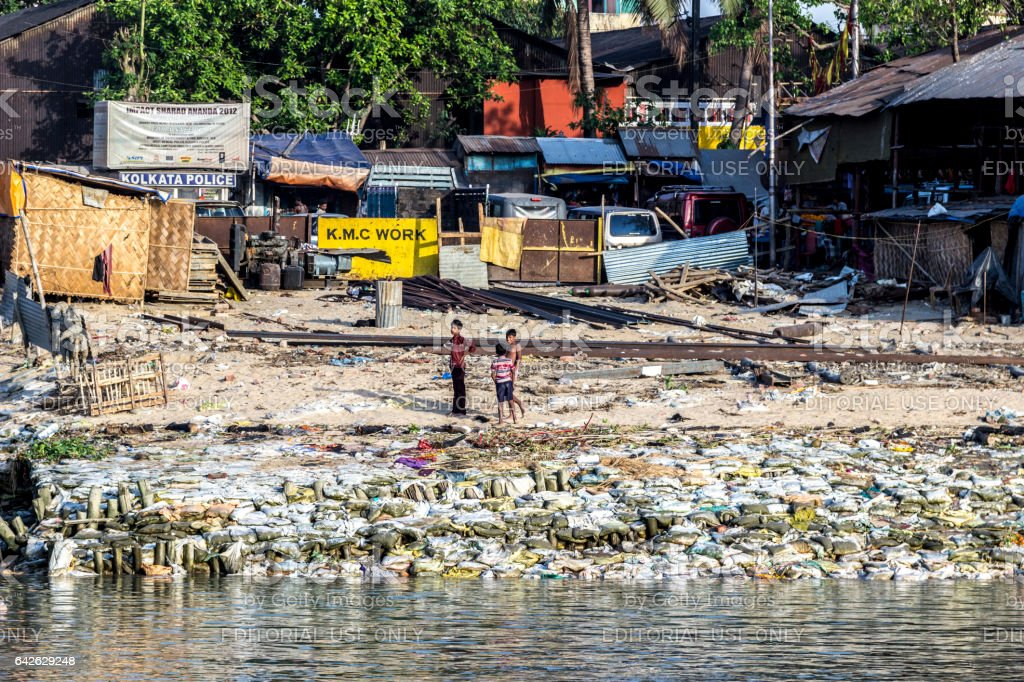 boys work in the dirts  litter area at river ganges stock photo