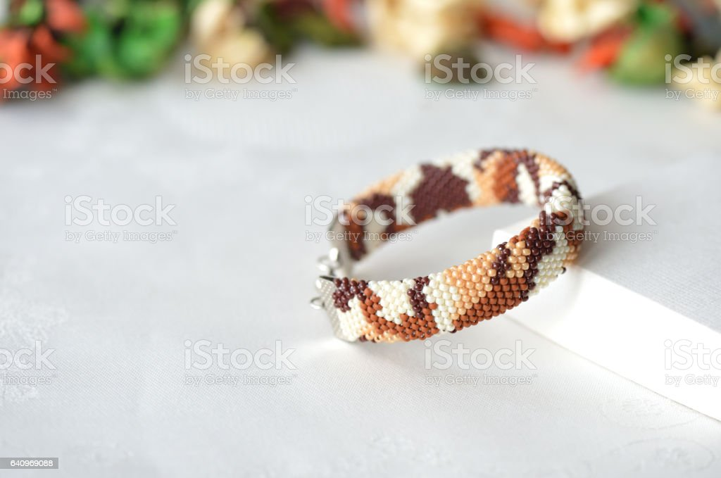 Bracelet in the style of desert camouflage close up stock photo