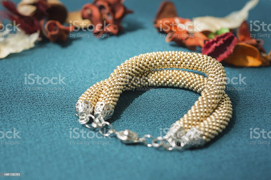 Bracelet of gold color from beads stock photo