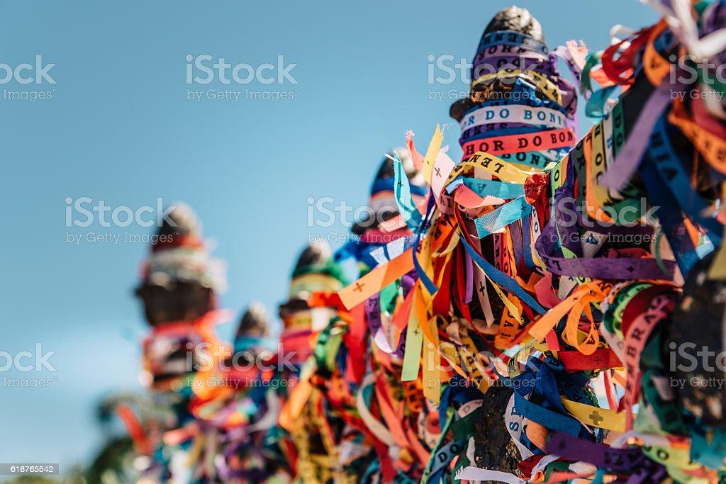 bracelet ribbons at fence of bomfim church in Salvador Brazil stock photo