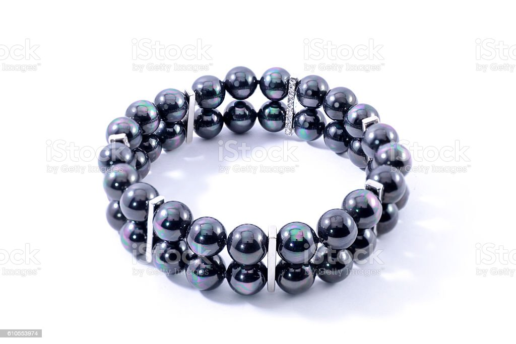 Bracelet with black pearls isolated on white stock photo