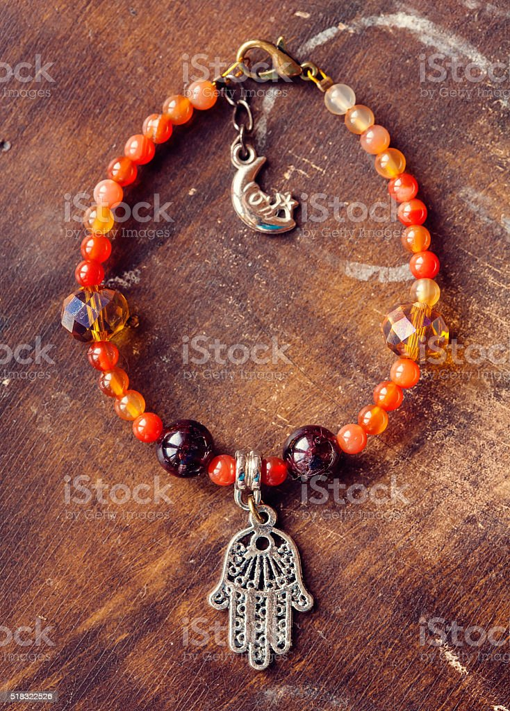 Bracelet with Fatima's hand pendant stock photo