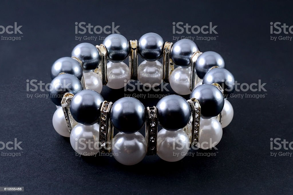 bracelet with pearls isolated on black stock photo