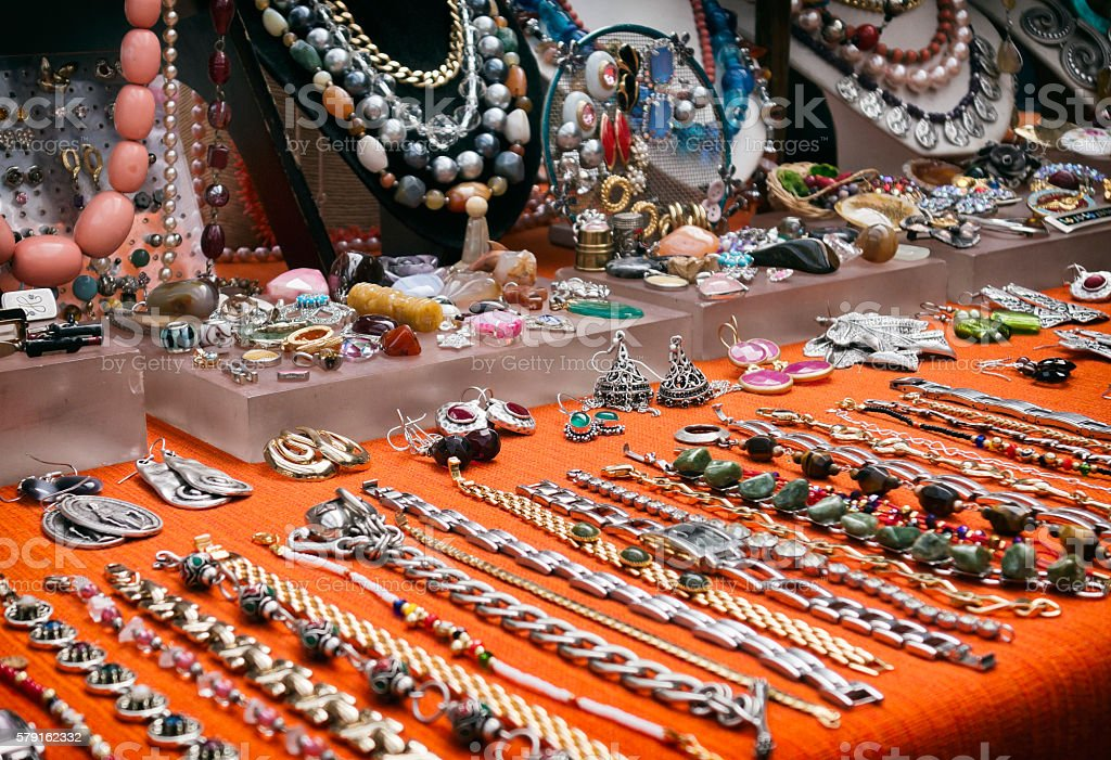 Bracelets and necklaces on a market stall stock photo