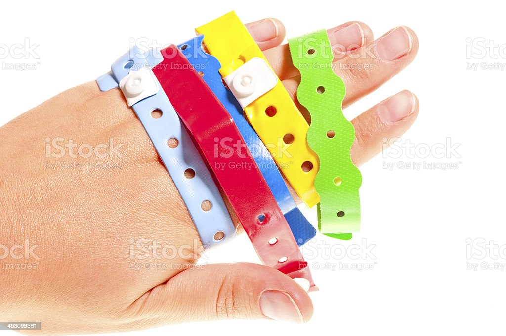 bracelets few hotels on a female hand stock photo