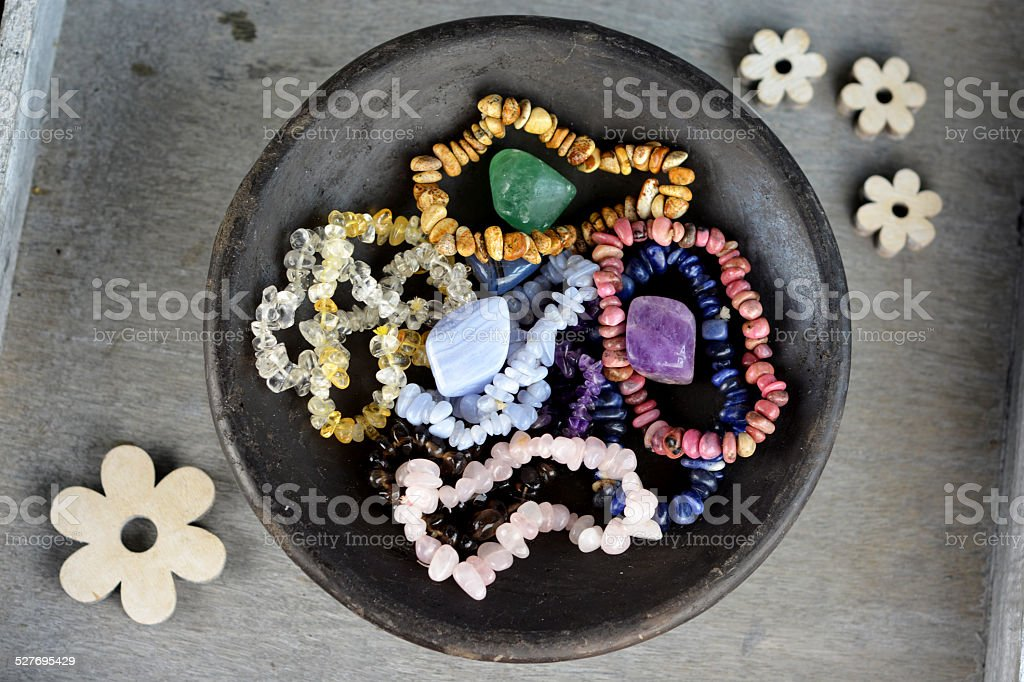 Bracelets of crystals and gemstones for a healing effect stock photo
