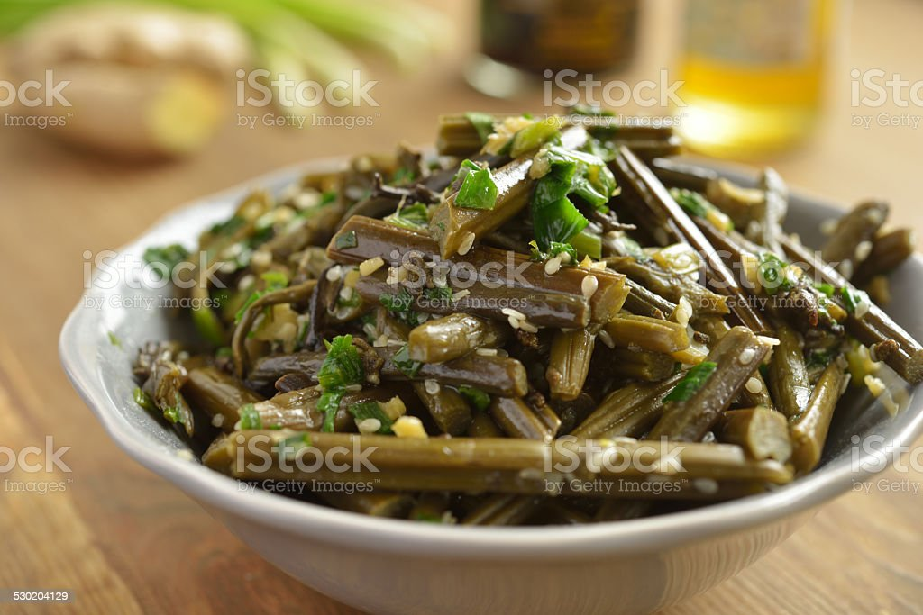Bracken fern salad stock photo
