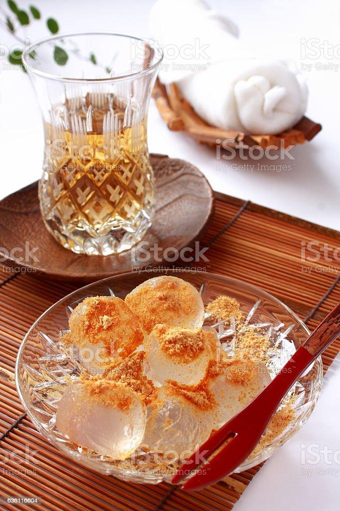 Bracken-starch dumplings Warabimochi and tea, Japanese food stock photo