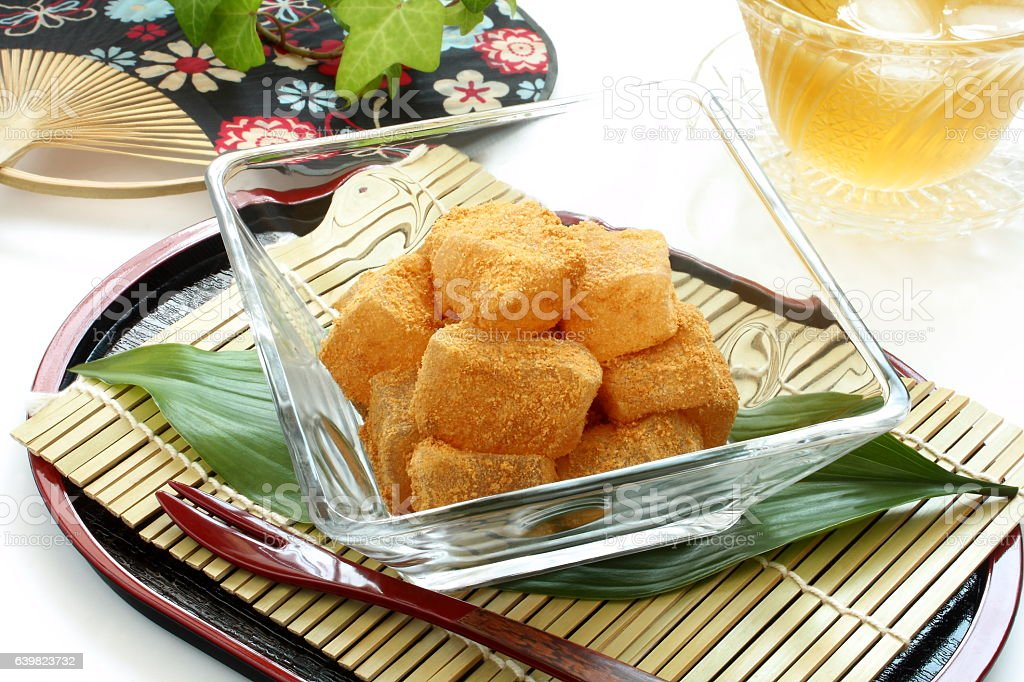 Bracken-starch Dumplings with Sweet Toasted Soybean Flour with tea stock photo
