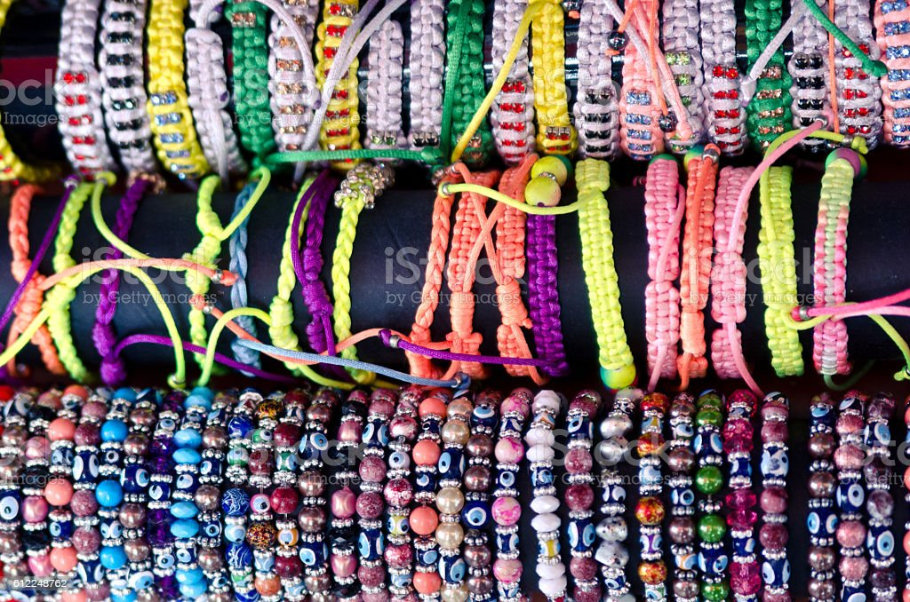 Braided bracelets and bracelets of beads with Nazar amulet bondzhuk stock photo