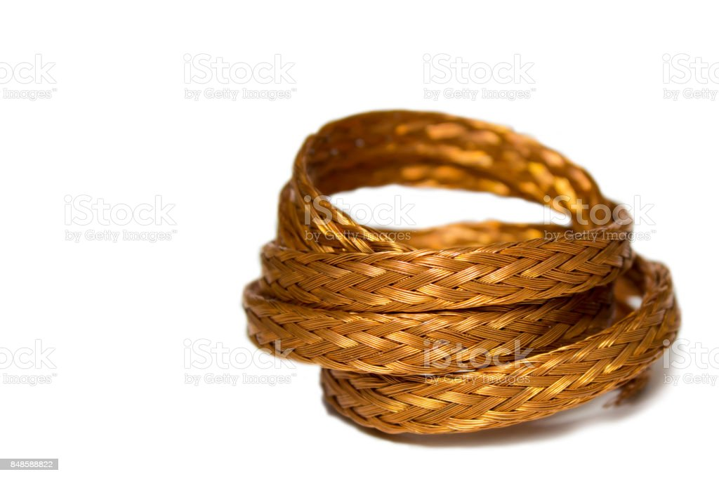 Braided copper wire twisted ring on a white background with space for text. stock photo