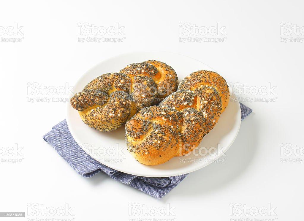 Braided poppy seed bread rolls stock photo