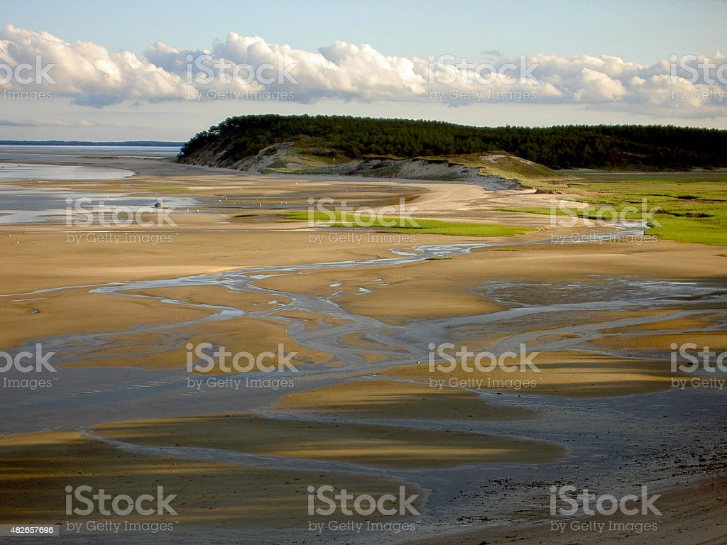 Braided Streams in Sand at Low Tide stock photo