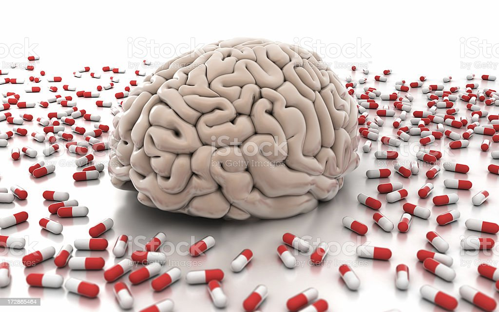 Brain surrounded by pills stock photo