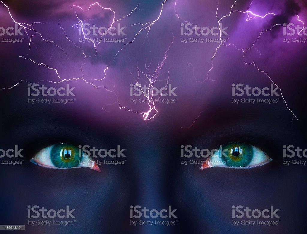 Brainstorm conceptualisation, lightnings on blue female forehead stock photo