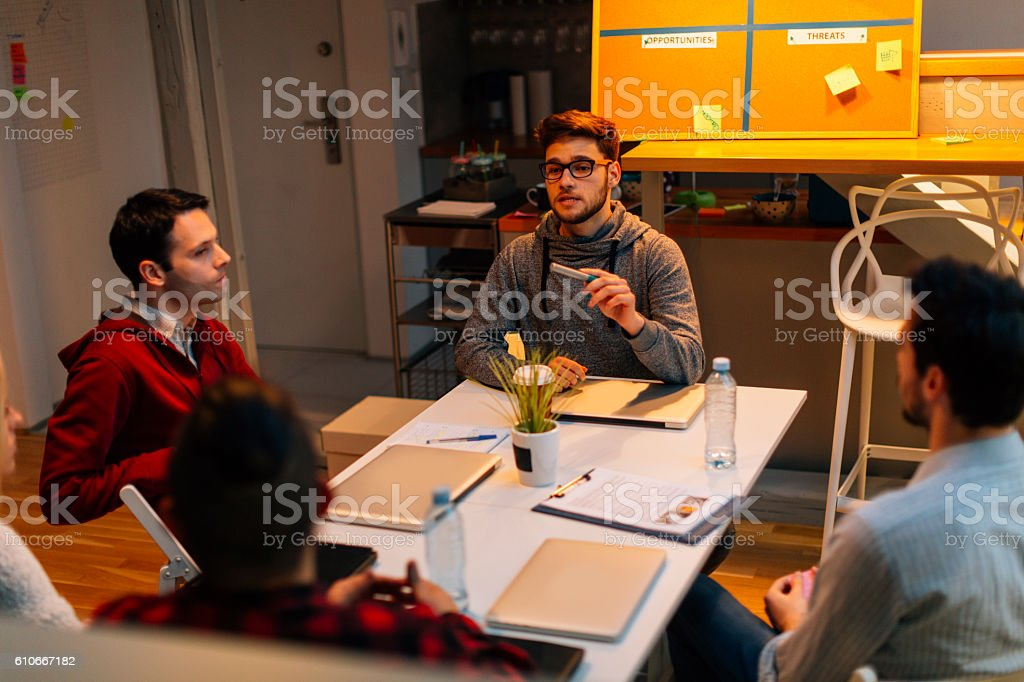 Brainstorming Late In Their Office. stock photo