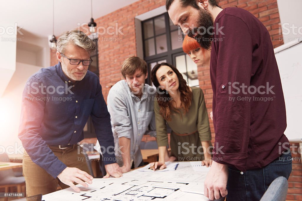 Brainstorming of stylish and creative architects stock photo