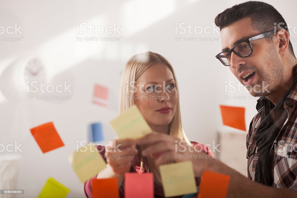 Braintorming with adhesive notes stock photo