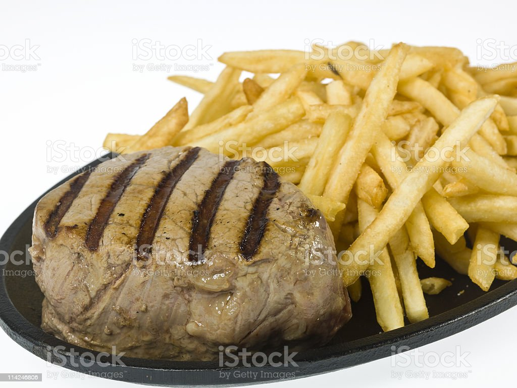 Braised Beef Steak with fries royalty-free stock photo