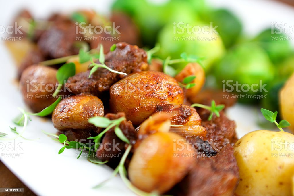 Braised beef with herbs and vegetables stock photo
