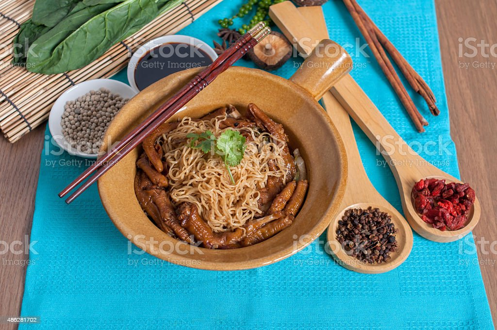 Braised goose feet with egg noodle menu stock photo