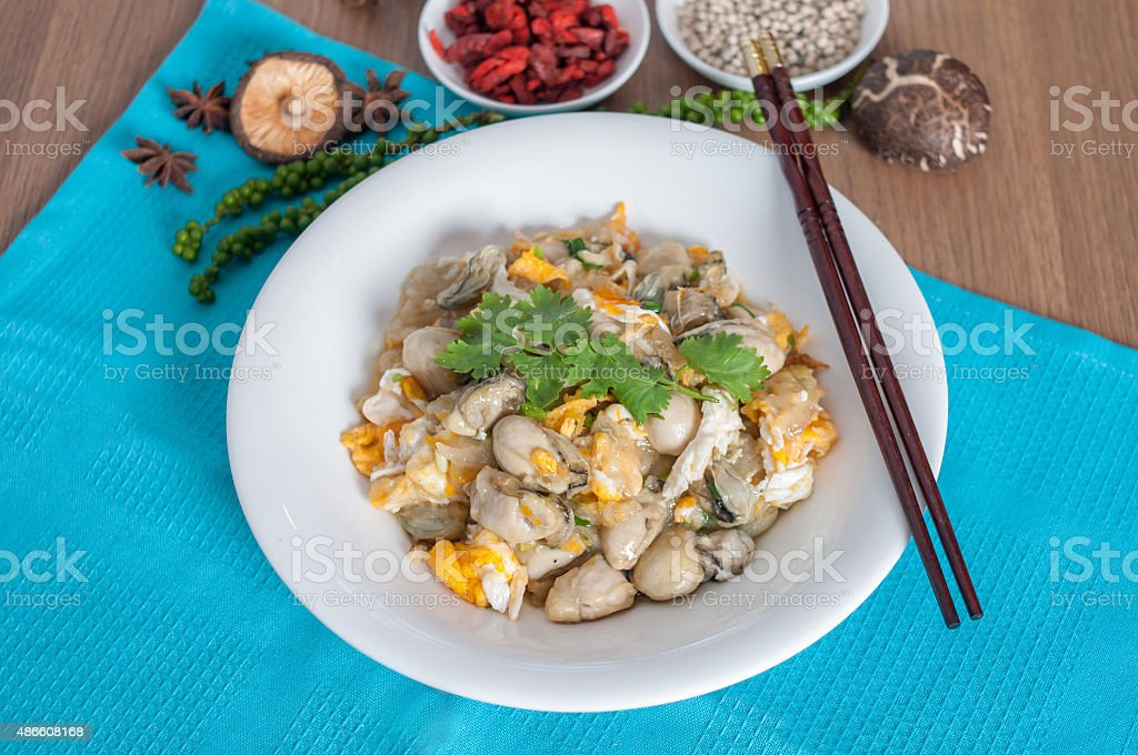 Braised oyster with eggs menu stock photo