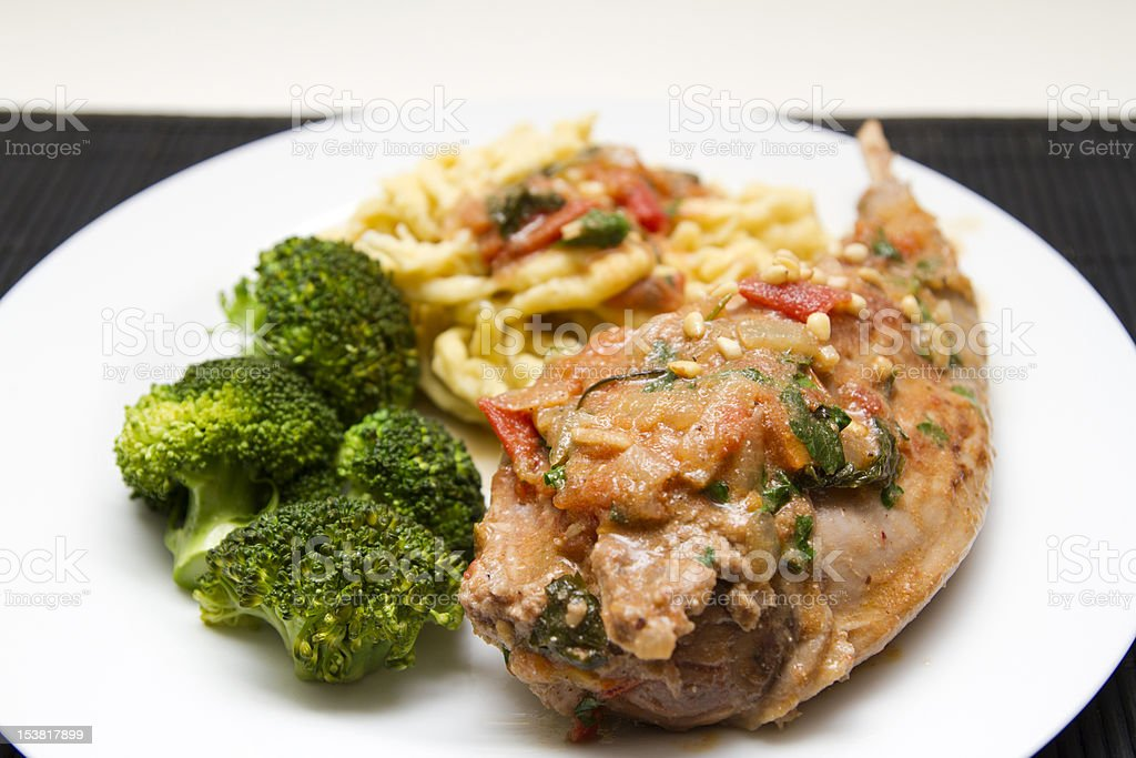 Braised rabbit with noodles and broccoli royalty-free stock photo