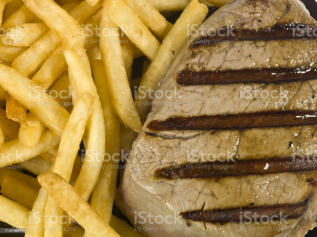 Braised Steak with fries close up royalty-free stock photo