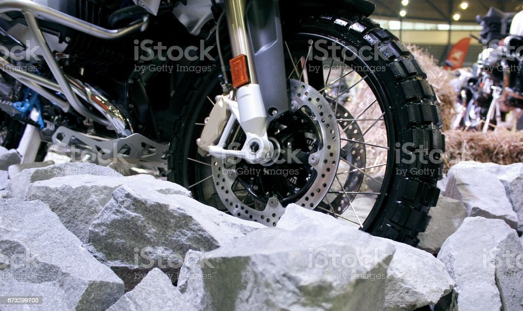 Brake disc and offroad tire on the adventure motorcycle stock photo