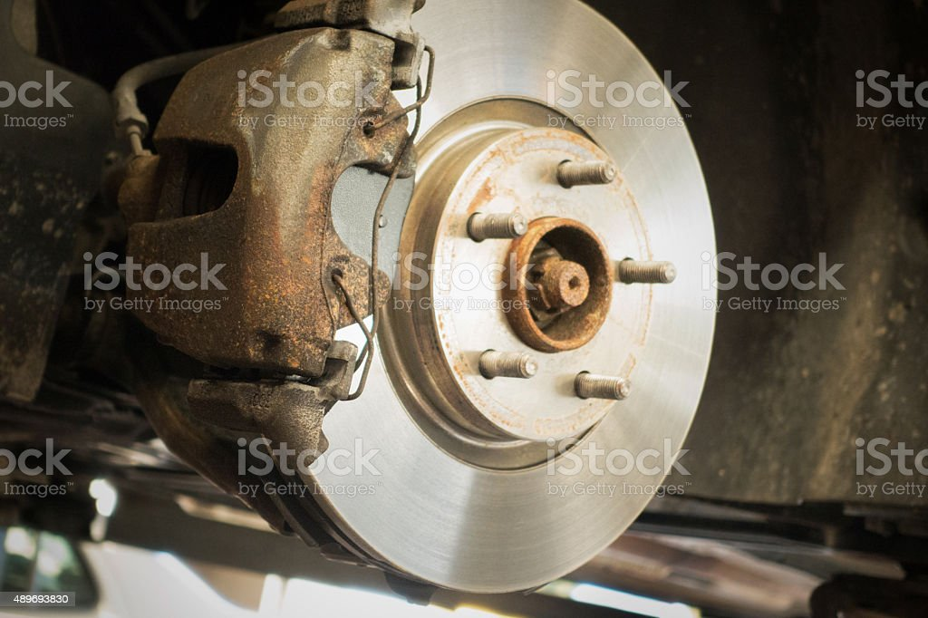 Brake disk from old car during repair service stock photo