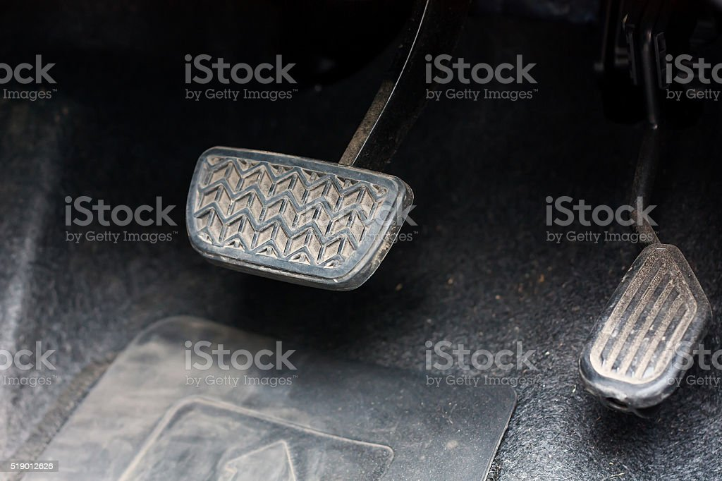 Brake pedal and accelerator stock photo