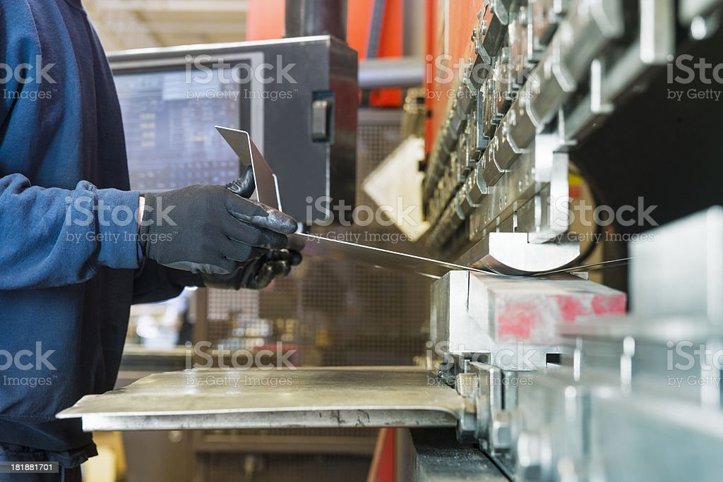 Brake press operator at work in a metal factory stock photo
